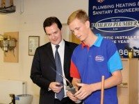 Chancellor George Osborne  with one of the Pimlico Plumbers apprentices during his recent visit to the London firm