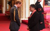 James Caan receiving his CBE from Prince William