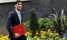 The budget will go ahead on 11 March, the Treasury said on Tuesday, forcing the new chancellor, Rishi Sunak, to piece together a fresh tax and spending programme over the next three weeks.