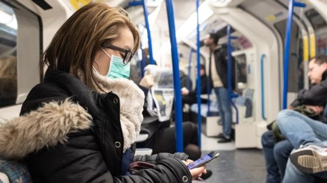 mask on tube train
