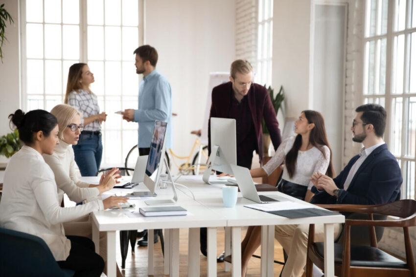 Diverse concentrated successful young businesspeople workday in modern office.