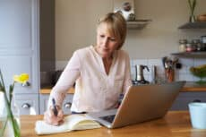 Woman Working From Home On Laptop In Modern Apartment