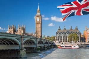 Big Ben and Houses of Parliament with boat in London, England, U