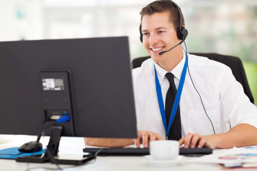 technical support operator working on computer