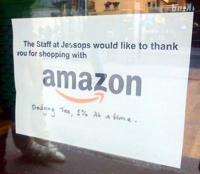 The sign that Jessops staff put in the window when they closed for the last time blaming their demise of the online retailer Amazon