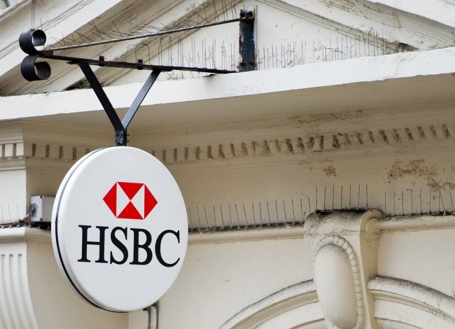 HSBC shares slide after 62% profit fall
