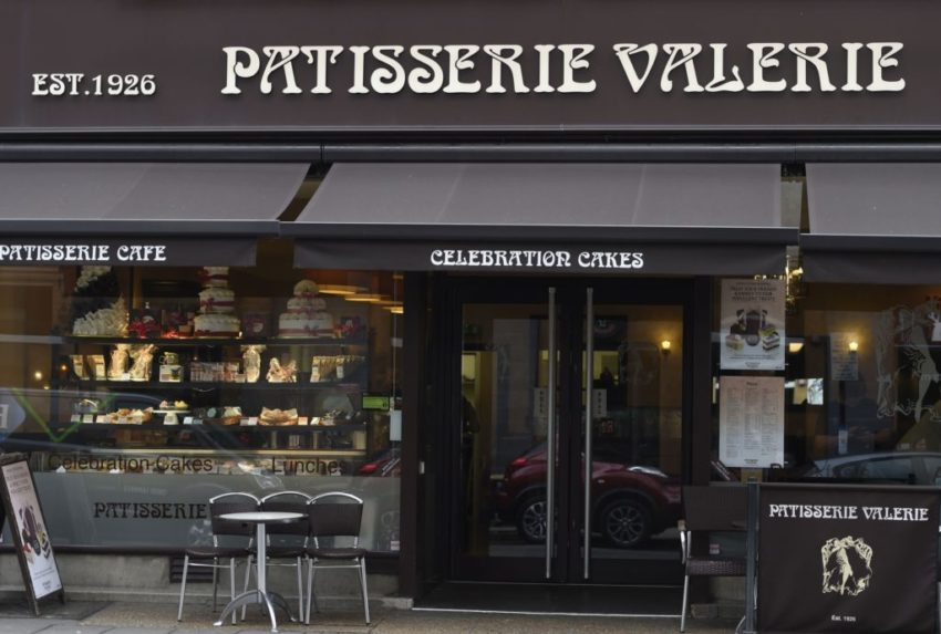 Patisserie Valerie chairman Luke Johnson has faced down sharp criticism from shareholders as the cafe chain gained backing for a rescue plan.