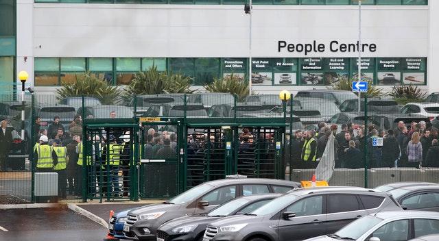 Jaguar Land Rover staff gather at work